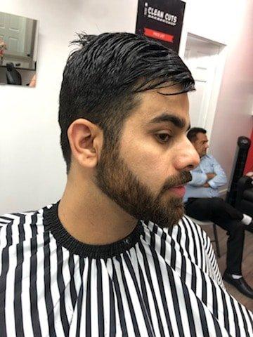 Clean Cut Barbershop .man looking at his face