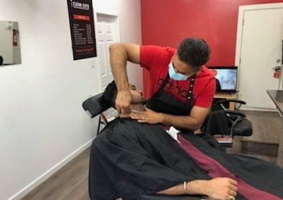 Clean Cut Barbershop working on hairs